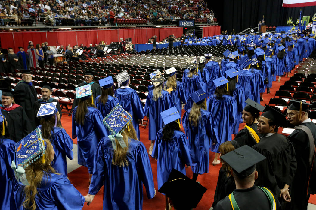 Graduates walk in the processional during College of Southern Nevada commencement ceremony at T ...