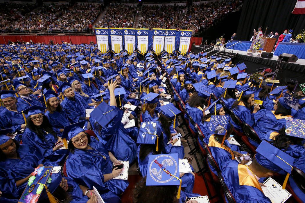 Graduates wave to their families during College of Southern Nevada commencement ceremony at Tho ...