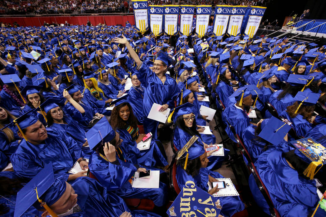 Veronica Gonzales waves to her family during College of Southern Nevada commencement ceremony a ...