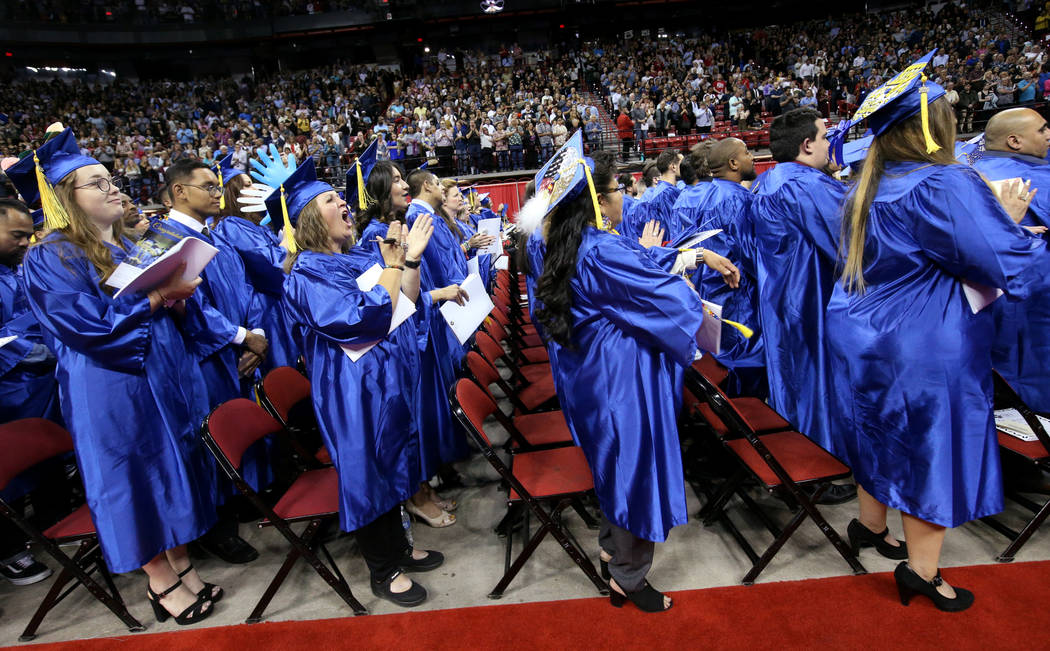 Graduates applaud during College of Southern Nevada commencement ceremony at Thomas & Mack ...