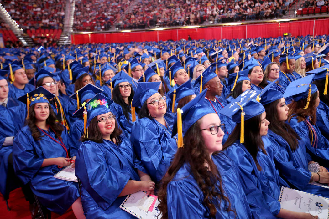 Graduates listen to speakers during College of Southern Nevada commencement ceremony at Thomas ...