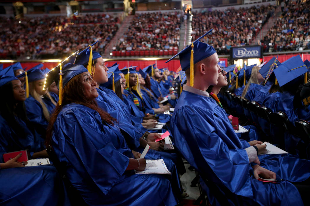 Graduates, including Ramona Schafer, left, listen to speakers during College of Southern Nevada ...