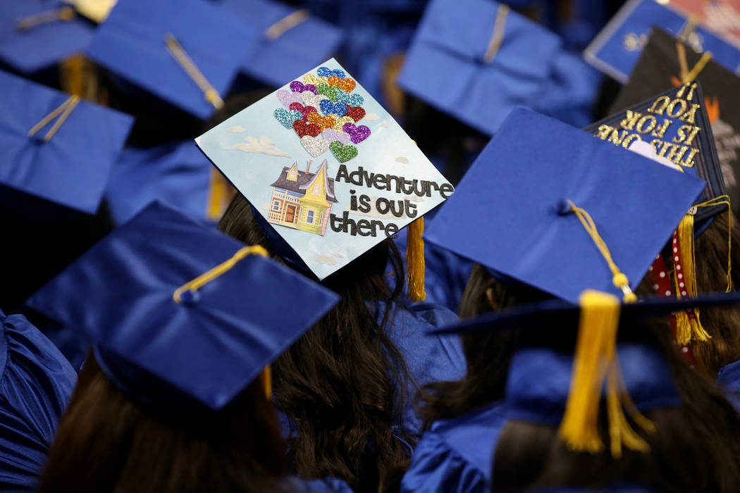 Graduates don personalized mortarboards during College of Southern Nevada commencement ceremony ...