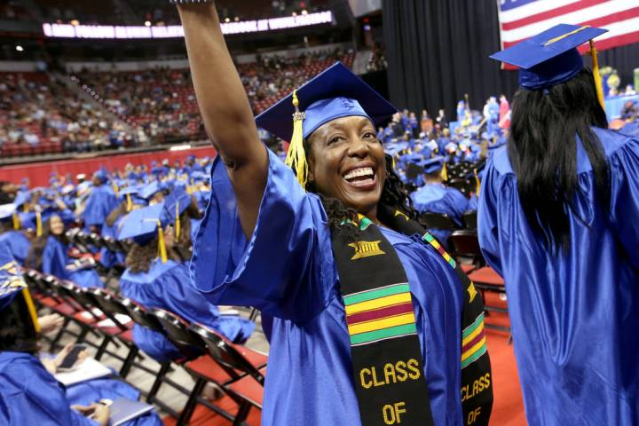 Victoria Lopez waves to her family during College of Southern Nevada commencement ceremony at T ...