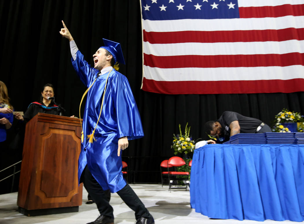 Miguel Nunez walks across the stage during College of Southern Nevada commencement ceremony at ...