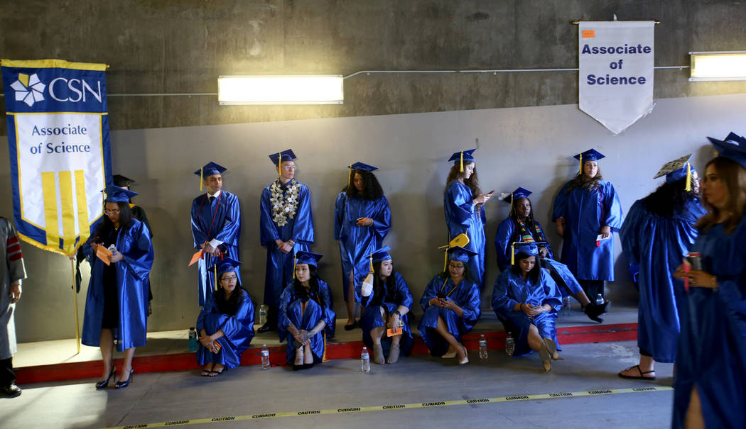 Graduates wait for the College of Southern Nevada commencement ceremony at Thomas & Mack Ce ...