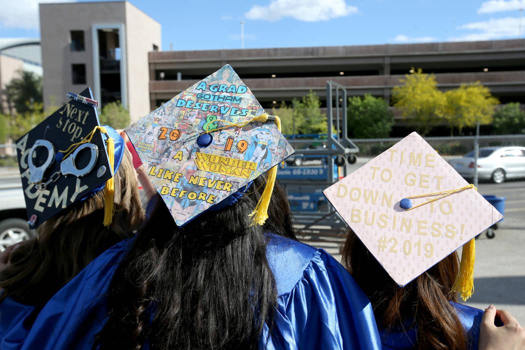 Graduates, from left, Jennifer Labelle, Amanda Rodriguez and Klarisse Policarpio don personaliz ...