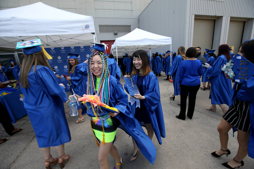 Graduates, including Yuriko Matsuo, left, prepare for the College of Southern Nevada commenceme ...