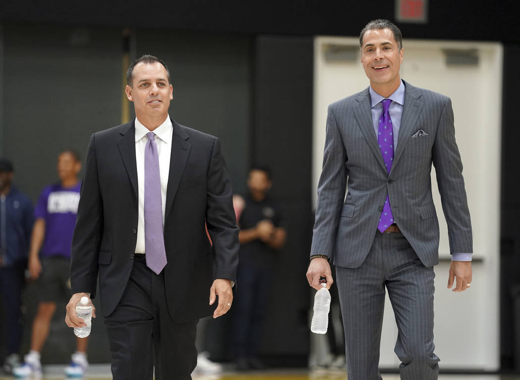 New Los Angeles Lakers NBA basketball team head coach Frank Vogel, left, and general manager Ro ...