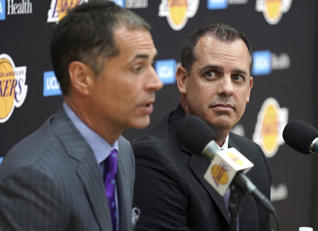 Los Angeles Lakers NBA basketball team general manager Rob Pelinka, left, introduces Frank Voge ...