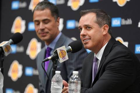 Los Angeles Lakers NBA basketball team general manager Rob Pelinka, left, introduces Frank Voge ...