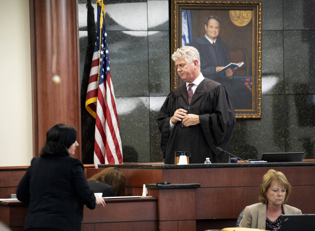 State Judge Eugene Griffith pauses the trial as Tim Jones' ex-wife Amber Kyzer breaks down whil ...