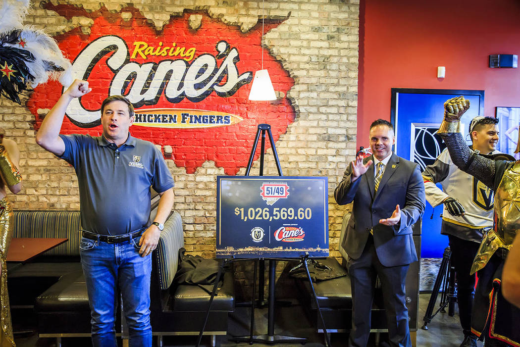 Raising Cane's founder Todd Graves, left, and Golden Knights Chief Marketing Officer Brian Kill ...