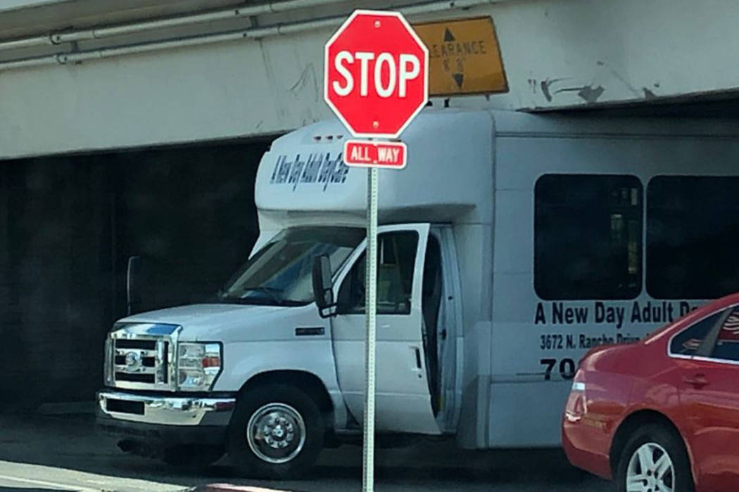A shuttle van is stuck underneath the U.S. Highway 95 underpass at Las Vegas Blvd. South on Mon ...