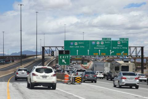 Motorists navigate through the newly completed Project Neon HOV flyover ramp in the Spaghetti B ...