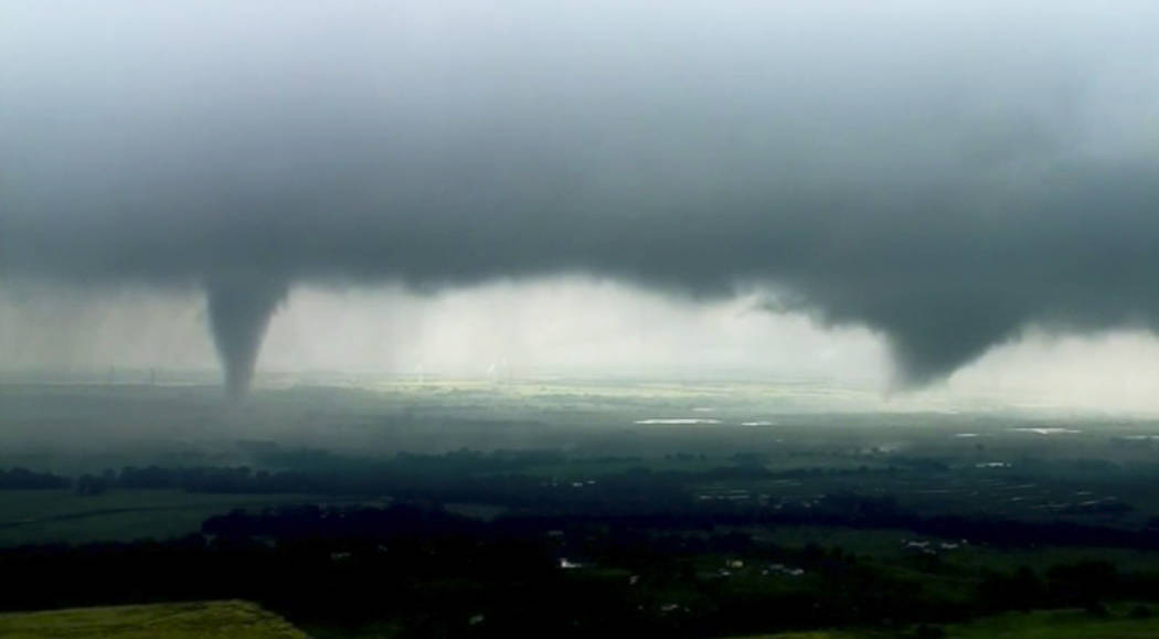 This image made from video provided by KWTV-KOTV shows two funnel clouds formed in Crescent, Ok ...