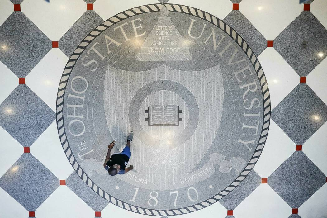 Pedestrians pass through The Ohio State University's student union, Saturday, May 18, 2019, in ...