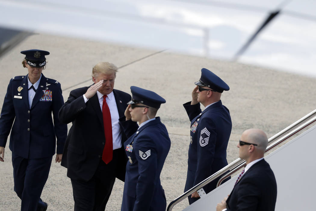 President Donald Trump boards Air Force One for a trip to a Montoursville, Pa., for a campaign ...