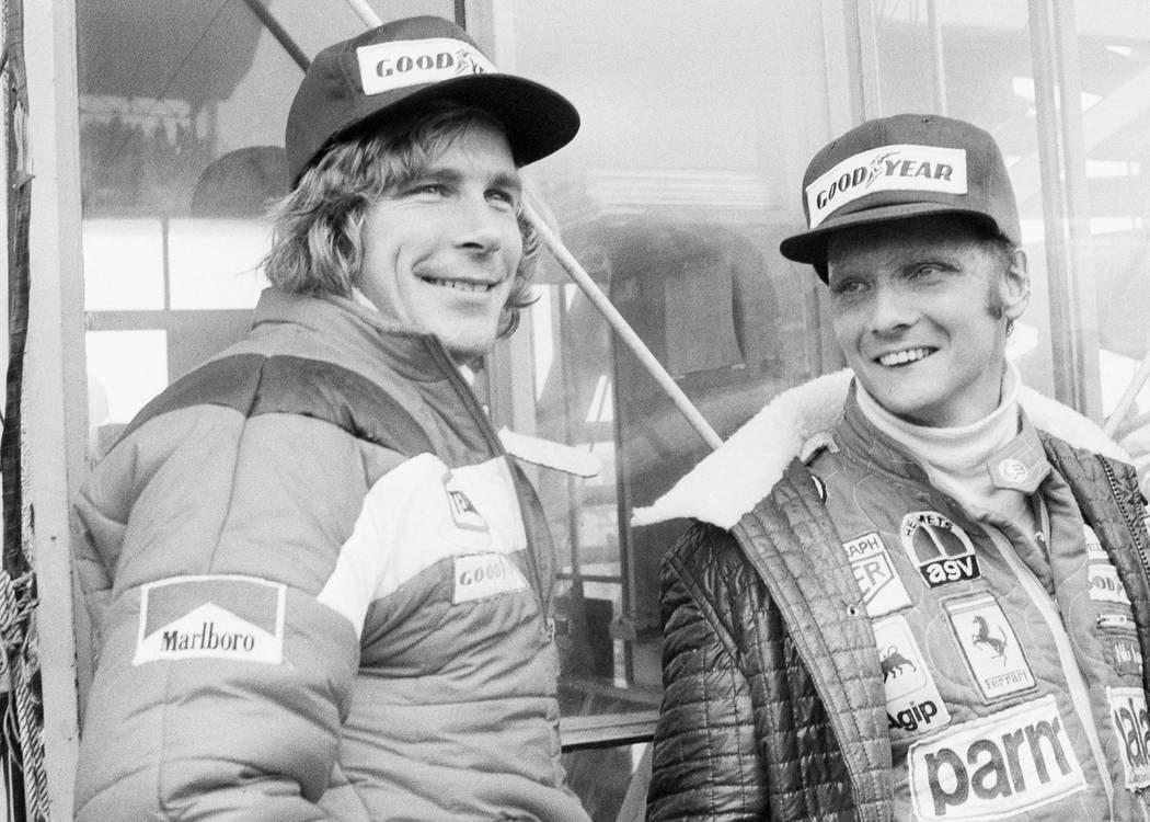 FILE - In this Oct. 24, 1976, file photo, Austrian auto racer Niki Lauda, right, defending cham ...