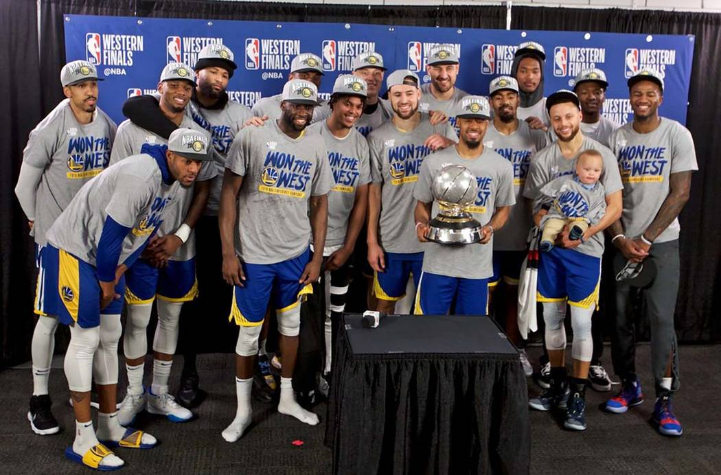 The Golden State Warriors players pose with the Western Conference Championship trophy after Ga ...
