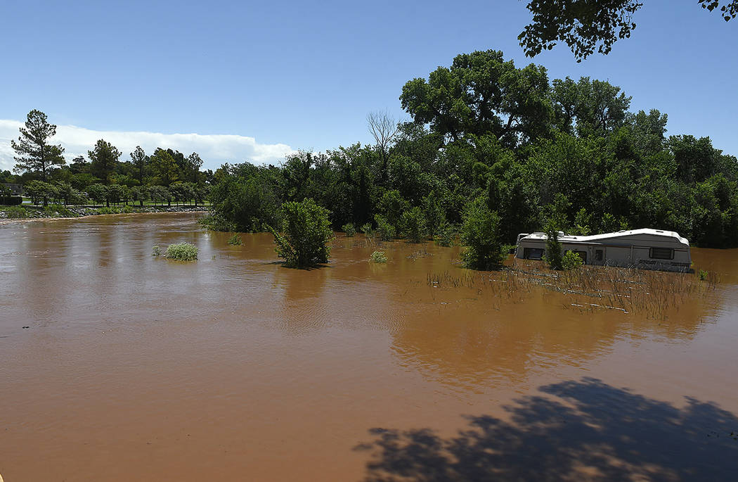 Uncle John Creek is overflowing it's banks in Kingfisher, Okla., Tuesday May 21, 2019. (Billy H ...