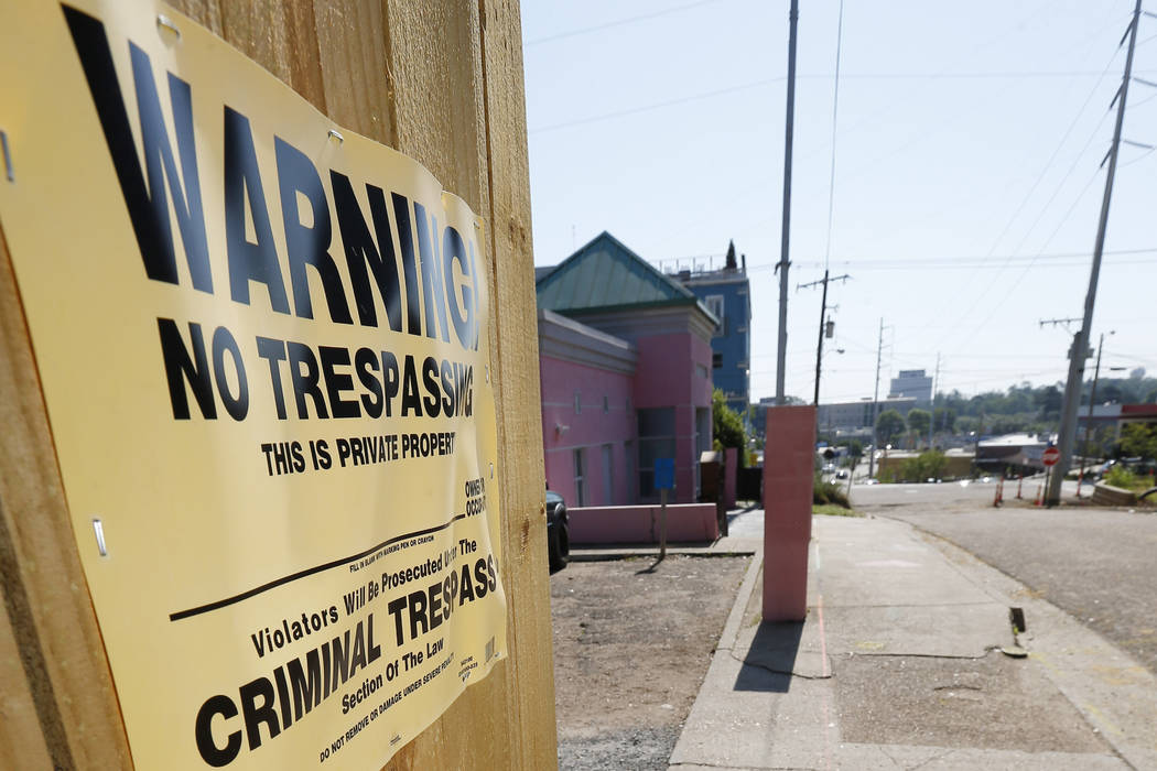 """A """"No Trespassing"""" sign is posted along the fencing protecting the parking lot of the ..."""