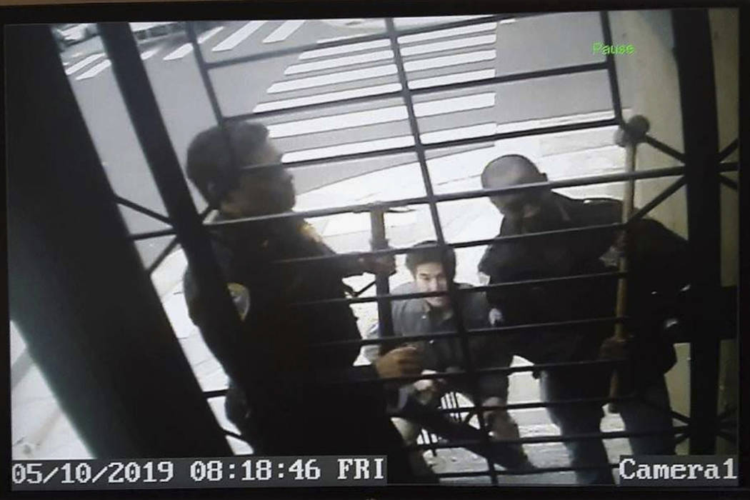 In this May 10, 2019, image from video provided by @bryancarmody, are San Francisco police arme ...