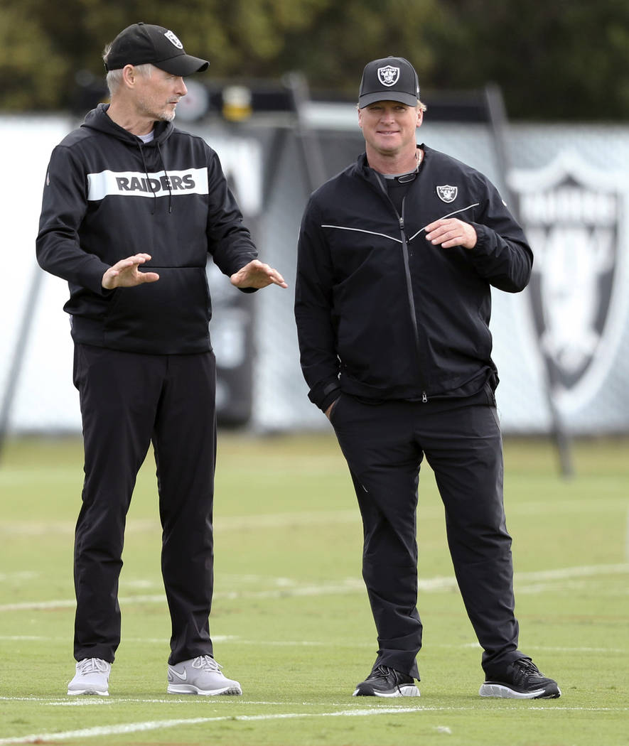 Oakland Raiders general manager Mike Mayock, left, and head coach Jon Gruden watch the team pra ...