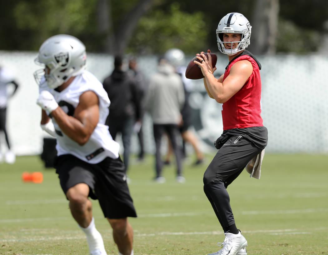 Oakland Raiders quarterback Derek Carr prepares to throw the football during an offseason train ...