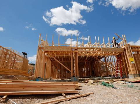 Workers construct houses near the corner of Mesa Park Drive and Hualapai Way in the Summerlin a ...
