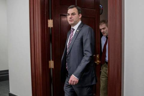 A March 28, 2017, file photo shows Rep. Justin Amash, R-Mich., followed by Rep. Jim Jordan, R-O ...
