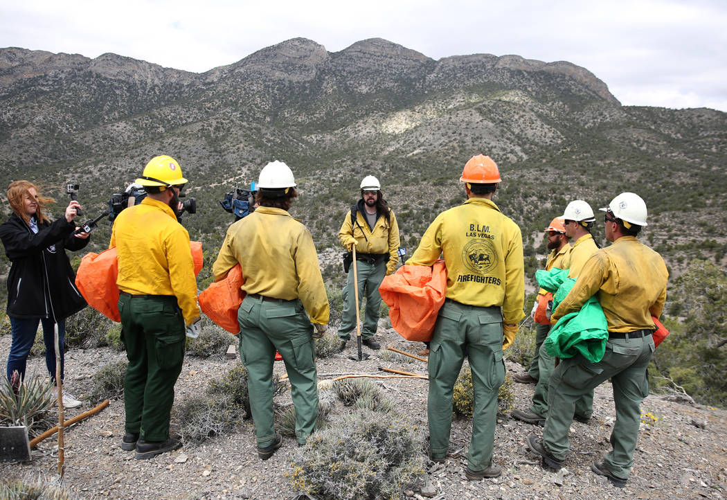 Andrew Merriam, center, squad leader and firefighter at Bureau of Land Management, speaks to hi ...