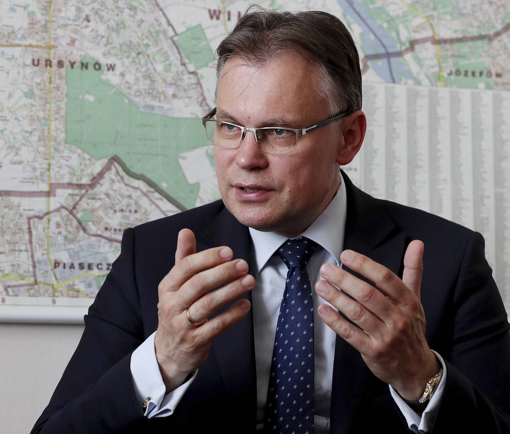 Poland's ruling party lawmaker Arkadiusz Mularczyk talks to The Associated Press in the parliam ...