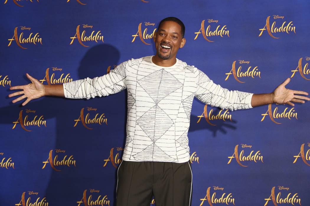 Actor Will Smith poses for photographers at the photo call for the film 'Aladdin' in London, Fr ...