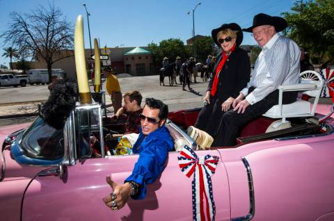 Elvis impersonator Jesse Garon, left, poses for a photographer with Mayor Carolyn Goodman, cent ...