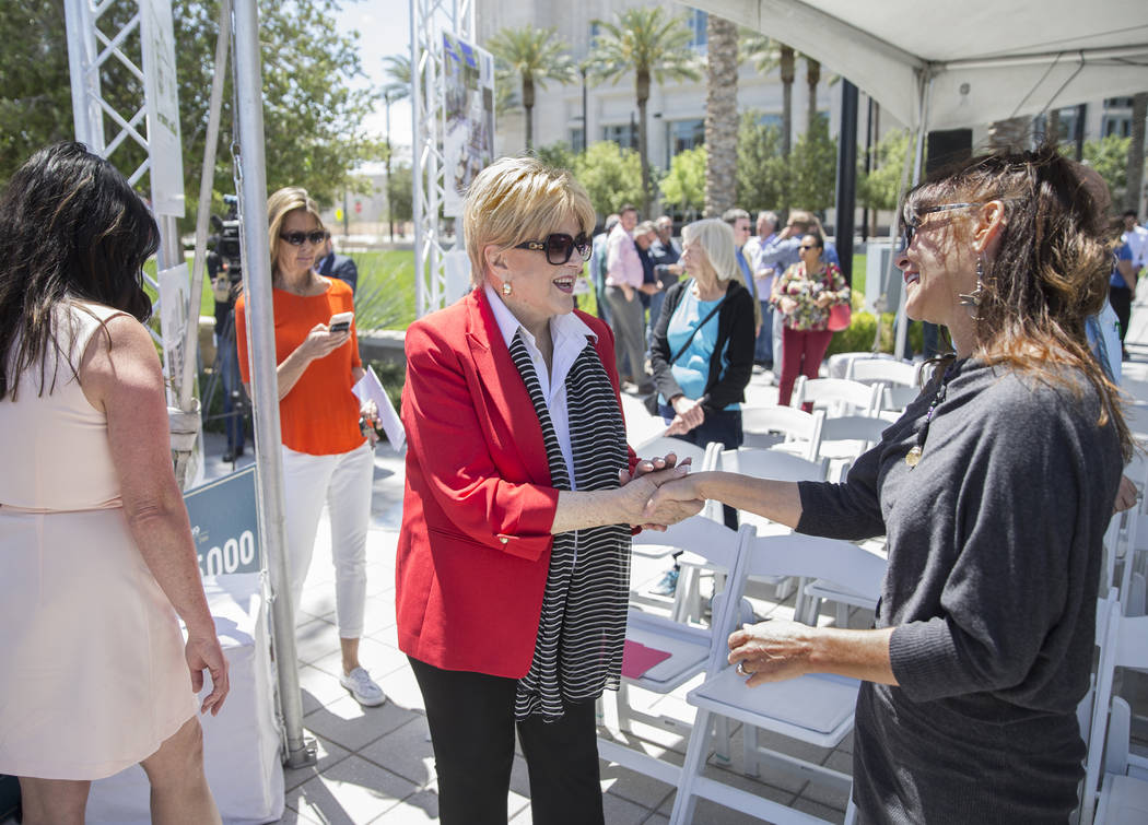 Mayor Carolyn Goodman, middle, shakes hands with artist Niki Sands during a ground breaking cer ...