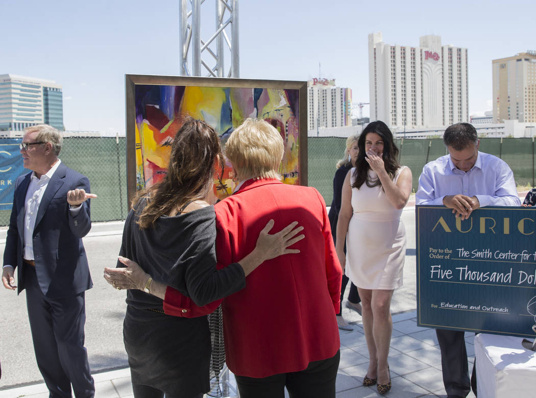 Mayor Carolyn Goodman, third from right, talks with artist Niki Sands about her painting during ...