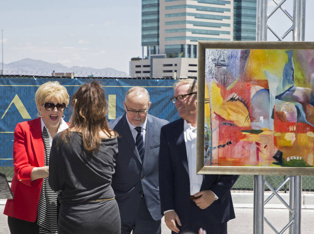 Mayor Carolyn Goodman, left, shakes hands with artist Niki Sands, as Myron Martin, president an ...