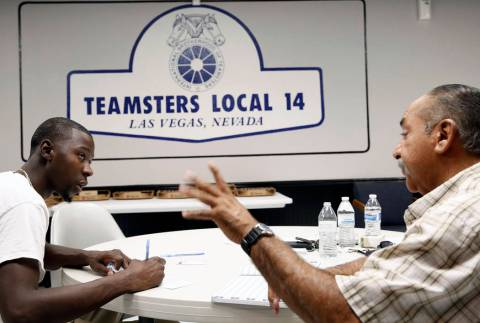 Ernie Ixtlahuac, right, Clark County School District Teamster activist, speaks to Larry Thomas ...