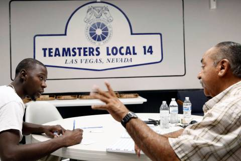 Ernie Ixtlahuac, right, Clark County School District Teamster activist, speaks to Larry Thomas ...