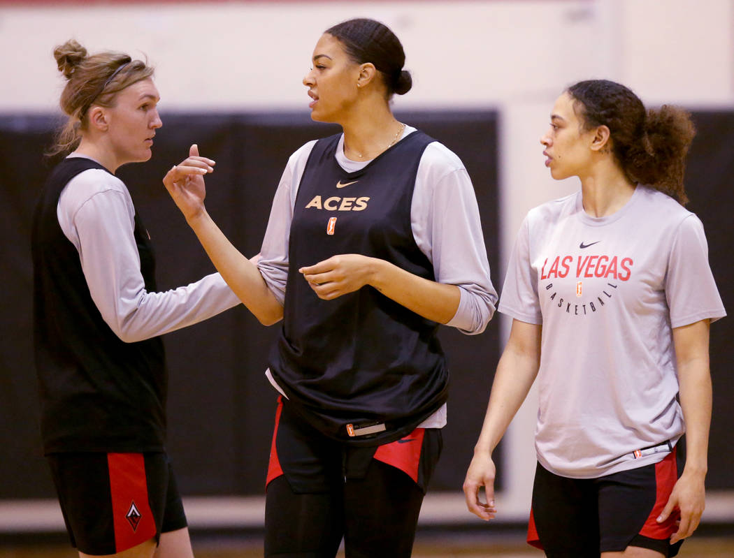 Aces center Liz Cambage, center, with Carolyn Swords, left, and Dearica Hamby during practice a ...