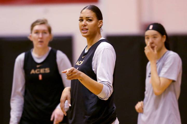 Aces center Liz Cambage, center, with forward Carolyn Swords, left, and center JiSu Park during ...