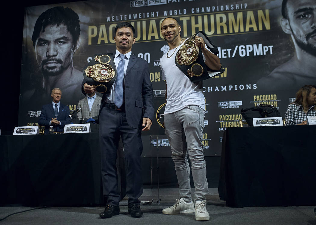 Manny Pacquiao, left, and Keith Thurman pose for a picture during a news conference on Tuesday ...