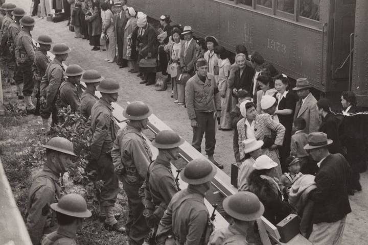 People wait for a train to take them to internment camps in this undated photo. (Courtesy)