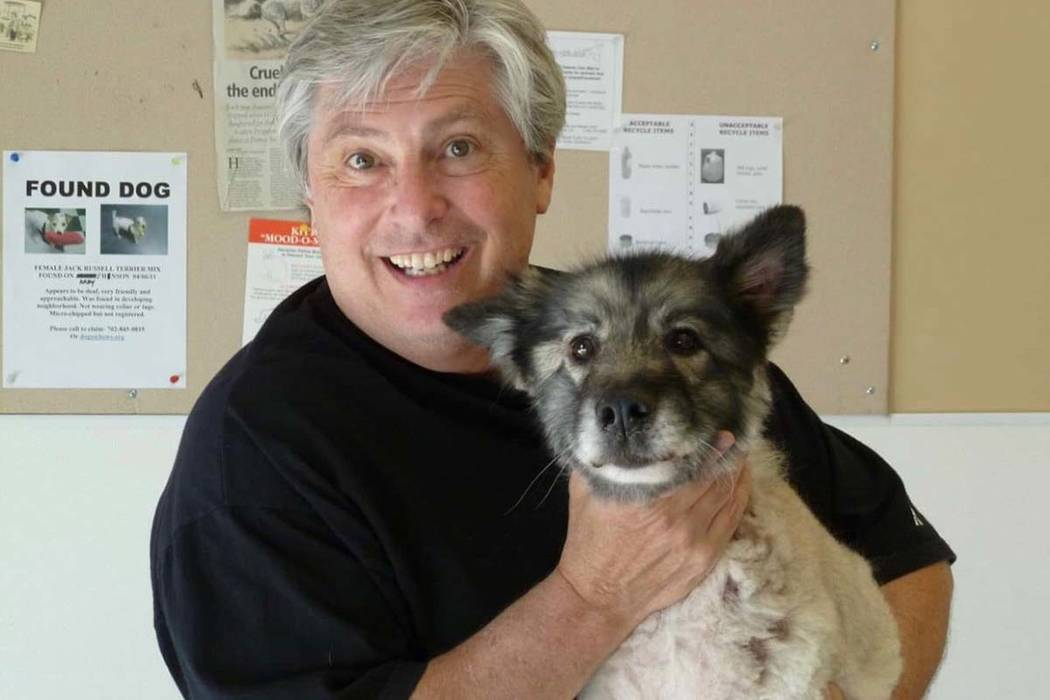 Harold Vosko poses with his late rescue dog, Grizzly. (Courtesy of Heaven Can Wait Animal Society)