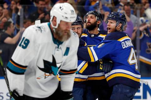 San Jose Sharks center Joe Thornton (19) skates past St. Louis Blues defenseman Carl Gunnarsson ...
