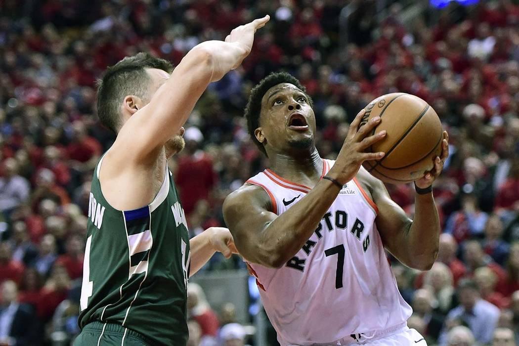 Toronto Raptors guard Kyle Lowry (7) drives for the basket as Milwaukee Bucks guard Pat Connaug ...