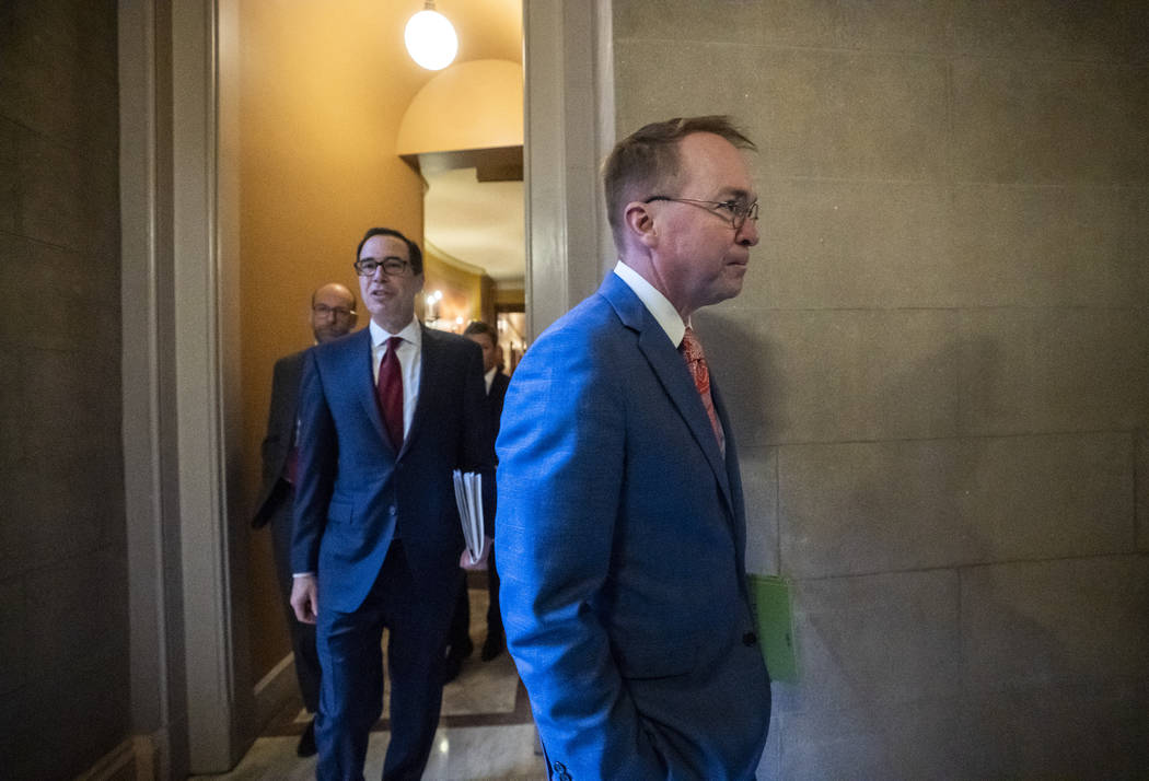 President Donald Trump's acting Chief of Staff Mick Mulvaney, center, and Treasury Secretary St ...