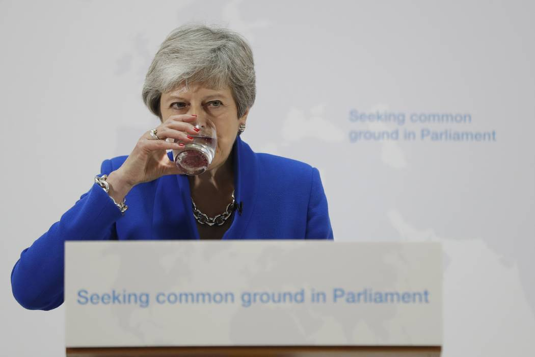 Britain's Prime Minister Theresa May drinks water during a speech in London, Tuesday, May 21, 2 ...