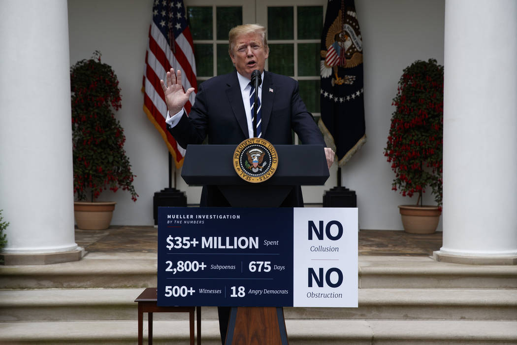 President Donald Trump delivers a statement in the Rose Garden of the White House, Wednesday, M ...